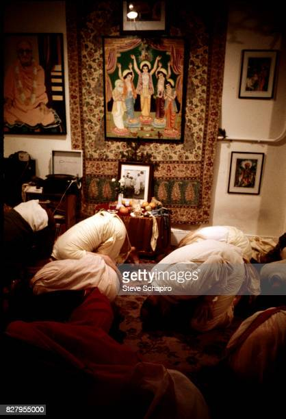 Devotees of the International Society for Krishna Consciousness better known as Hare Krishnas worship at their storefront temple New York 1968...