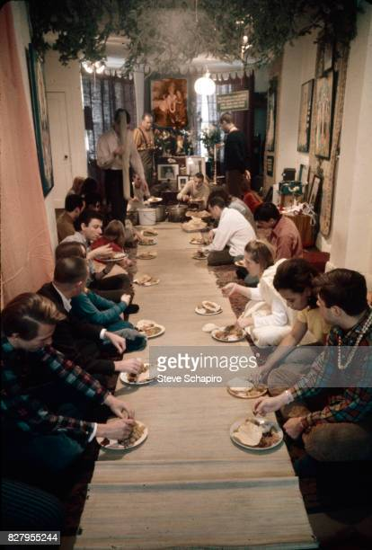 Devotees of the International Society for Krishna Consciousness better known as Hare Krishnas eat together at their storefront temple New York 1968...