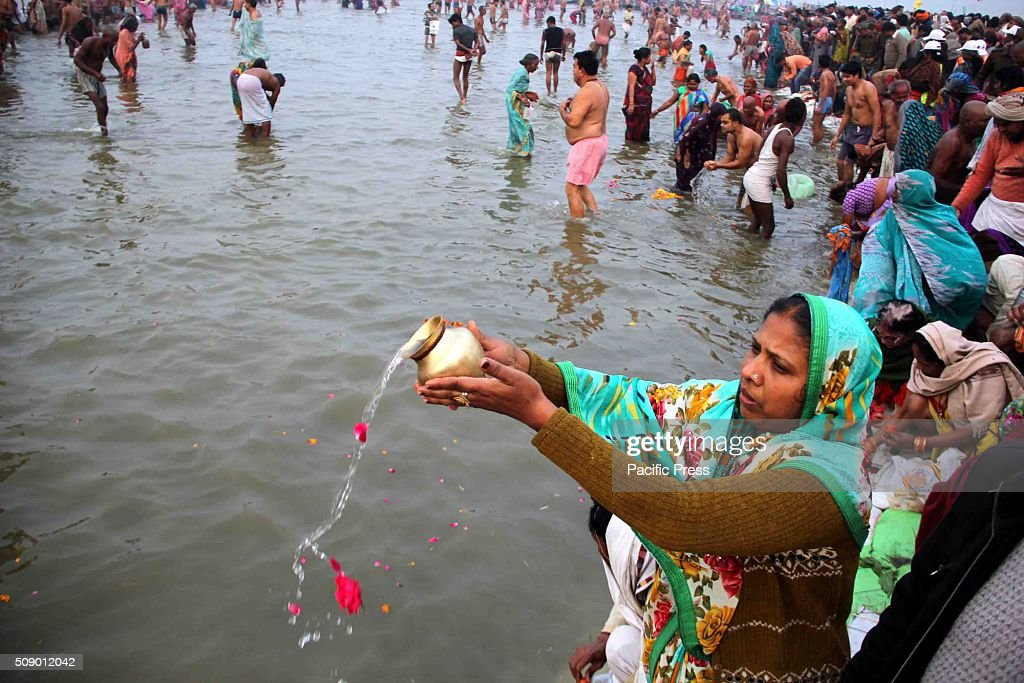 Devotees offer prayer in river Ganges on the occasion of 'Mauni Amavasya' or bath festival during the one month long Magh Mela festival.