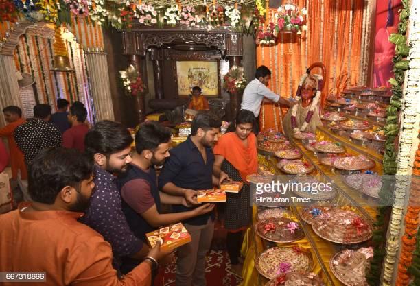 Devotees offer prayers on the occasion of Hanuman Jayanti at Hanuman Mandir at Link Road near Karol Bagh on April 11 2017 in New Delhi India This day...