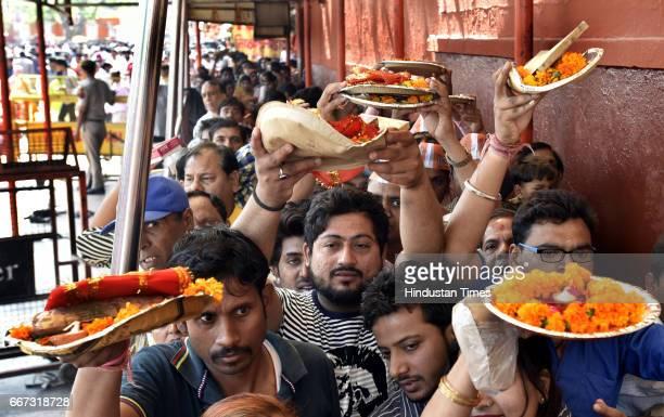Devotees offer prayers on the occasion of Hanuman Jayanti at Hanuman Mandir at Yamuna Bazar on April 11 2017 in New Delhi India This day marks the...