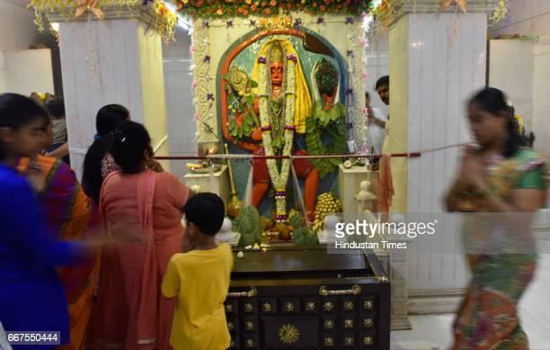 Devotees offer prayers to Lord Hanuman on the occasion of Hanuman Jayanti at Khada Hanuman Mandir Worli on April 11 2017 in Mumbai India Hanuman...