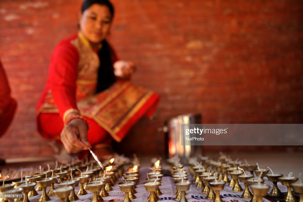 Devotees offering butter lamps during Lord Narayan jatra festival in Hadigaun, Kathmandu, Nepal on Friday, October 06, 2017. Once in a every year right after Dashain Festival this festival celebrates. The Narayan Jatra Festival of Hadigaun is a unique Festival in the capital involving three circular bamboo structures, above which an idol of the Lord Narayan in placed, and then rotated by two people standing below.