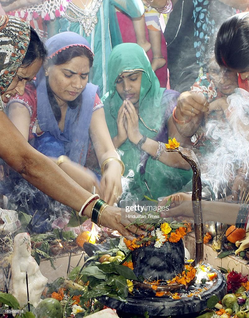 Devotees offering prayer to Shivling on occasion of Shivratri Festival on March 10, 2013 in New Delhi, India. Literally meaning great night of Shiva or the night of Shiva, Maha Shivaratri is celebrated every year on the 13th night/14th day of the Maagha or Phalguna month of the Hindu calendar. According to Hindu legends this is day of Samundra Manthan as well as day of Marriage of Lord Shiva to Devi Parvati.