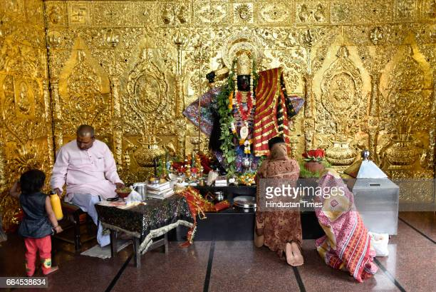 Devotees offering prayers on Asthami the eighth day of the festival of Navratri at Mata Mandir on April 4 2017 in New Delhi India Asthami is the...