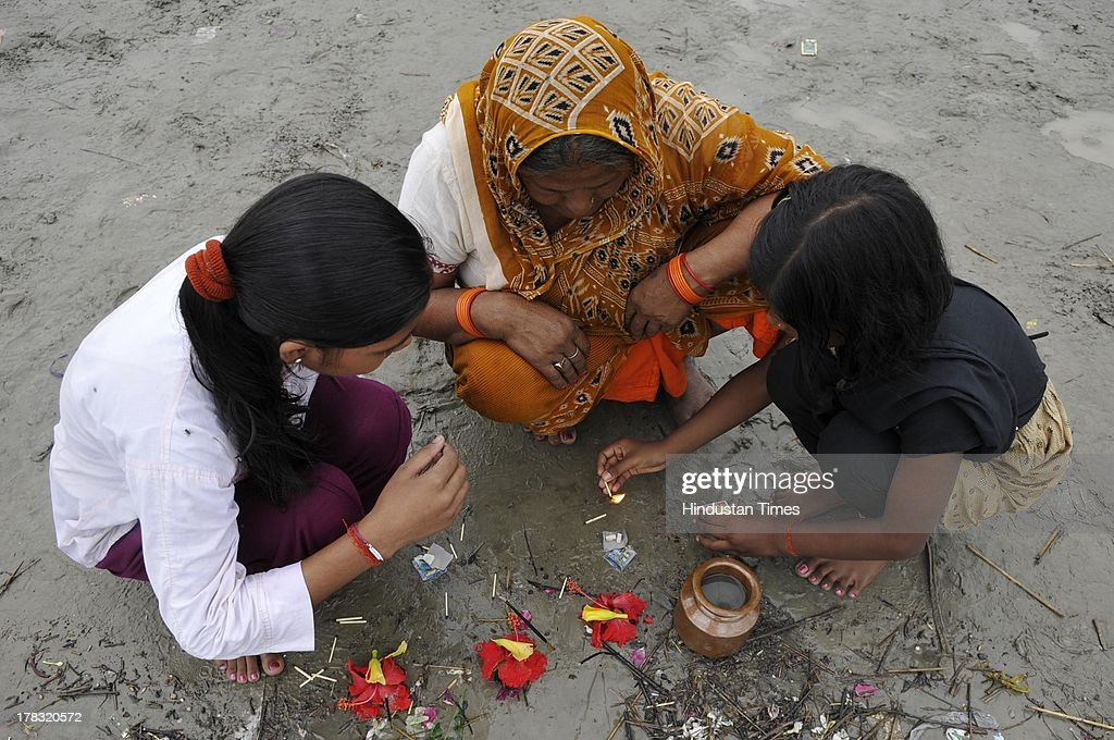 Devotees offering prayers on the beds of Saryu Ghat on August 28, 2013 in Ayodhya, India. Three days after Vishwa Hindu Parishad (VHP) field Parikarma attempt, Ayodhya saw a heavy presence of security personnel amid Janmashtmi celebrations.