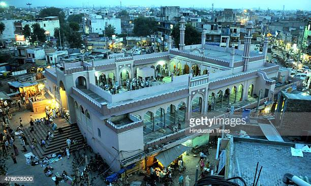 Devotees offering the Juma Namaz during Ramadan at Jama Masjid Sadar Bazar on June 26 2015 in Gurgaon India Muslims throughout the world are...