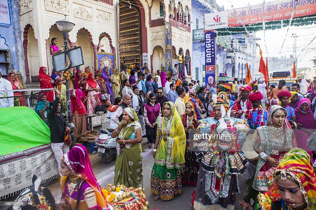 Devotees participate in a procession, showcasing artists and children dressed as various Gods and Godesses, through a street during the Pushkar Camel Fair in Pushkar, Rajasthan, India, on Sunday, Nov. 22, 2015. Throw together hundreds of thousands of rural Indians, colorful festivals and throngs of tourists and you get the annual Pushkar Fair. Photographer: Prashanth Vishwanathan/Bloomberg via Getty Images