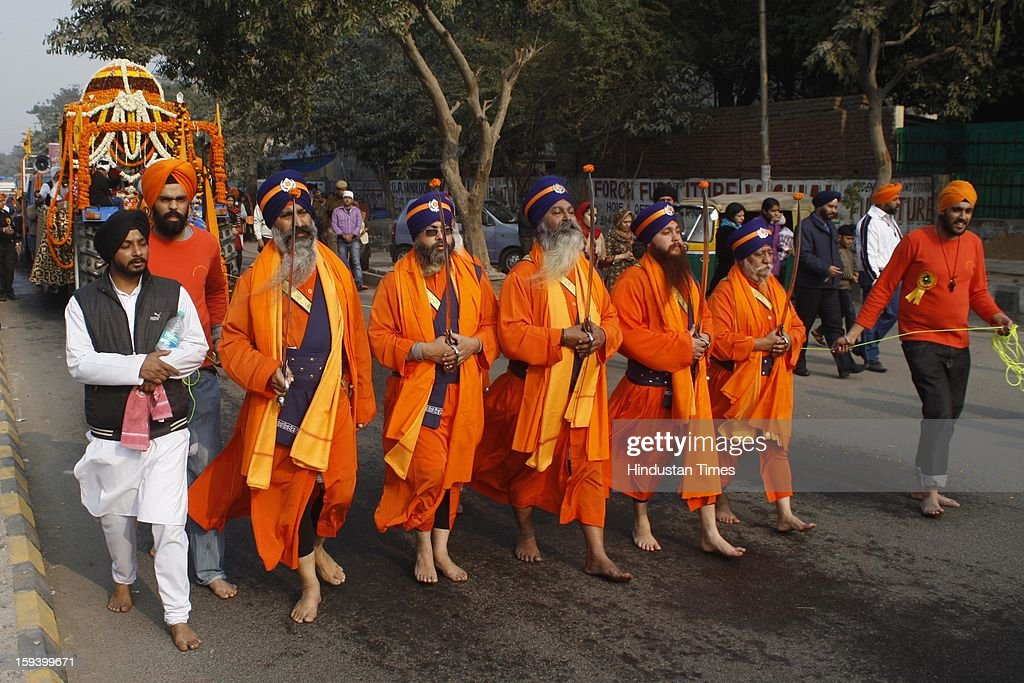 Devotees participate in a religious procession on the occasion of Prakash Parv of the 10th Guru of Sikh Community Guru Gobind Singh at Sector 25, on January 13, 2013 in Noida, India.