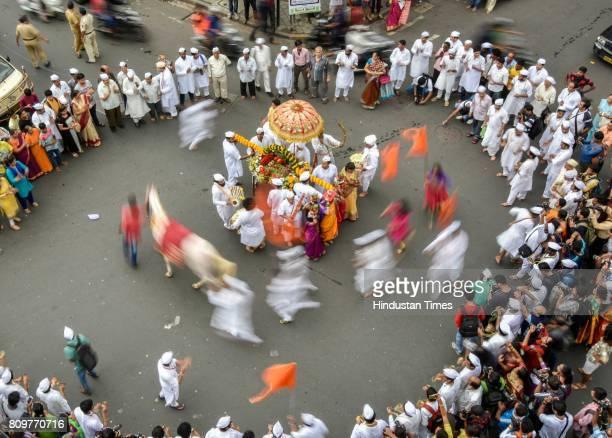 Devotees participate in procession during Girgaon Varkari Sampraday Dindi Palkhi Sohla at Girgaon on July 2 2017 in Mumbai India Wari is Maharashtras...