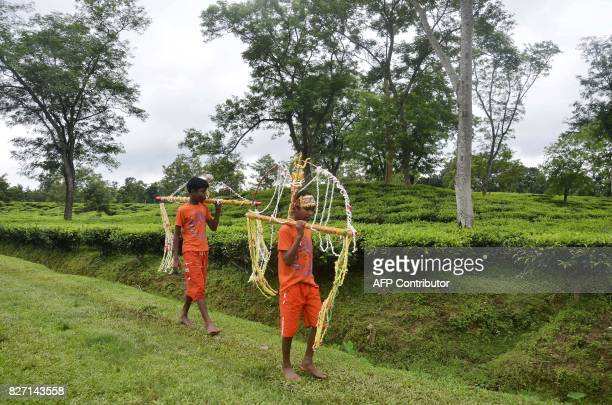 TOPSHOT Devotees participate in the Kanwar Yatra pilgrimage on the occasion of Sawan festival in Dharmanagar in the northeastern state of Tripura on...