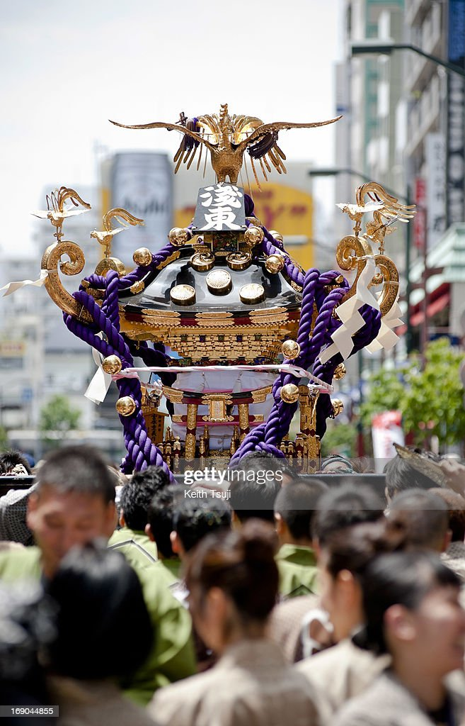 Devotees participate in the Sanja Matsuri festival at the Asakusa Shrine on May 19 2013 in Tokyo Japan Sanja Matsuri is considered one of the wildest...