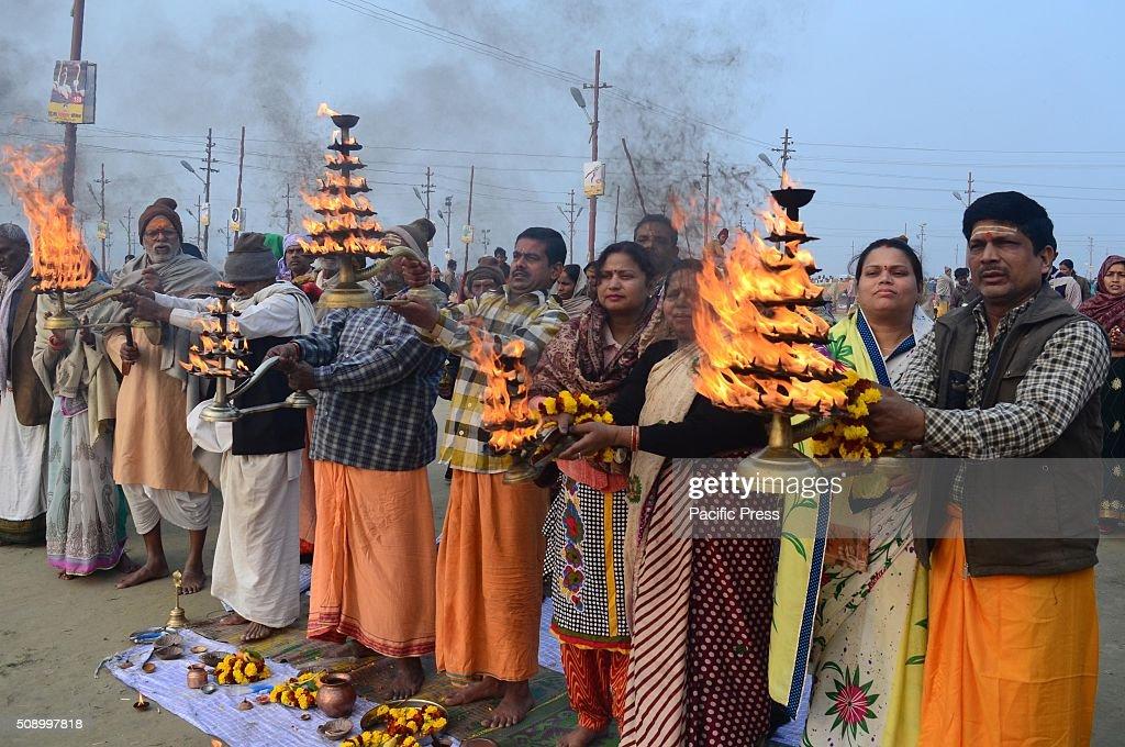 Devotees performing prayer after taking holydip at Sangam, the confluence of River Ganga Yamuna and mythological Saraswati during Magh mela festival.