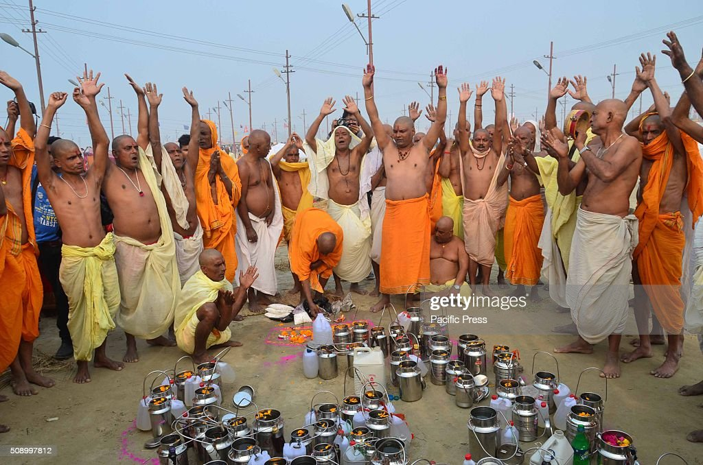 Devotees performing prayer after taking holydip on the occasion of Maghi Purnima the main holy bathing day at Sangam, the confluence of River Ganga Yamuna and mythological Saraswati during Magh mela festival.