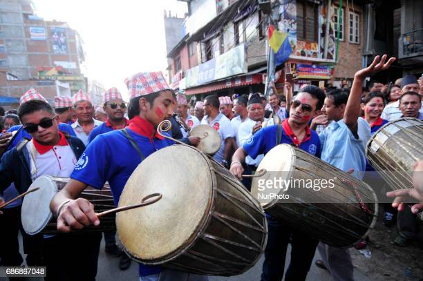 Devotees playing and dancing in a tunes of traditional instruments during last day of chariot pulling festival of Rato Machindranath 'God of Rain' at...