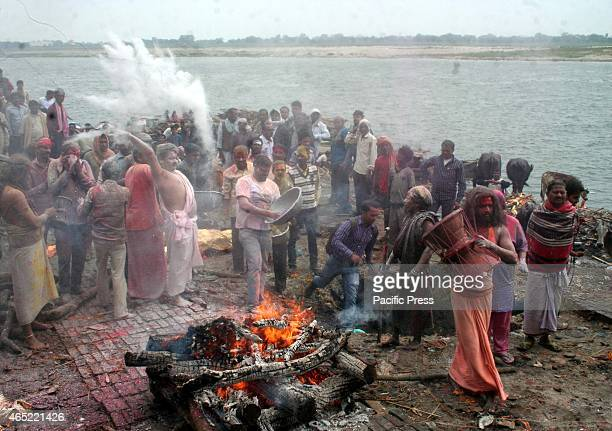 Devotees playing mythological and ancient holi manikarnika ghat in river bank of Ganga Varanasi Holi is an important festival to Hindus It is...
