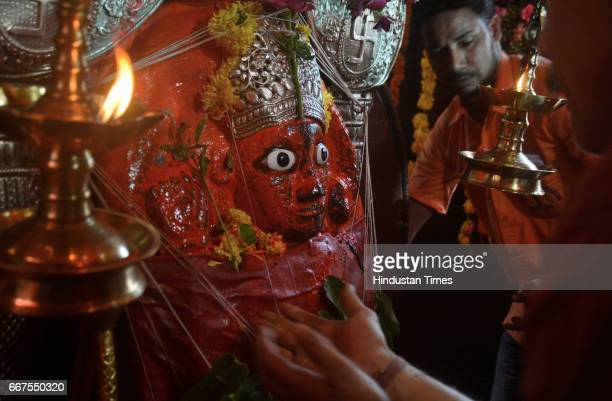 Devotees praying on the eve of Hanumath Jayanti which is celebrated to commemorate the birth of Lord Sri Hanuman taken at IIT Powai on April 11 2017...