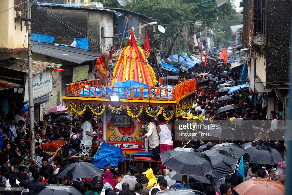 Devotees pull the chariots of Lord Jagannath, Balabhadra and Subhadra during the traditional Jagannath Rath Yatra at Sakinaka, Andheri East on July 10, 2013 in Mumbai, India. Lord Jagannath is presiding deity of 12th century shrine at Puri in Odisha. Apart from Puri annual Rath Yatras are taken out all the country and world by devotees with fanfare, religious fervor and a spirit of camaraderie.