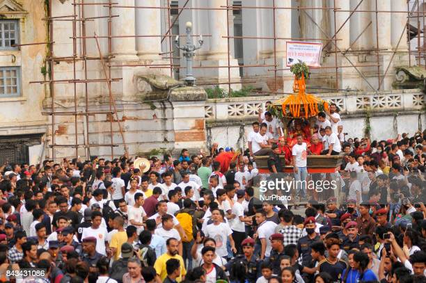 Devotees pulling the chariot of God 'Ganesh' on the fourth day of Indra Jatra Festival celebrated at Basantapur Durbar Square Kathmandu Nepal on...