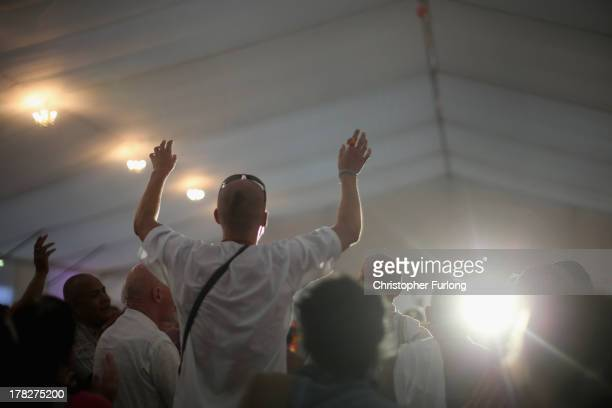 Devotees sing the Hare Krishna mantra during the Janmashtami Hindu Festival at Bhaktivedanta Manor on August 28 2013 in Watford England Up to 72000...