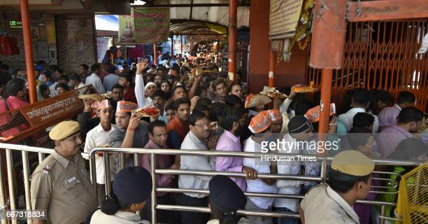 Devotees stand in queue on the occasion of Hanuman Jayanti at Hanuman Mandir at Yamuna Bazar on April 11 2017 in New Delhi India This day marks the...