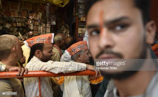Devotees stand in queue on the occasion of Hanuman Jayanti at Hanuman Mandir at Link Road near Karol Bagh on April 11 2017 in New Delhi India This...
