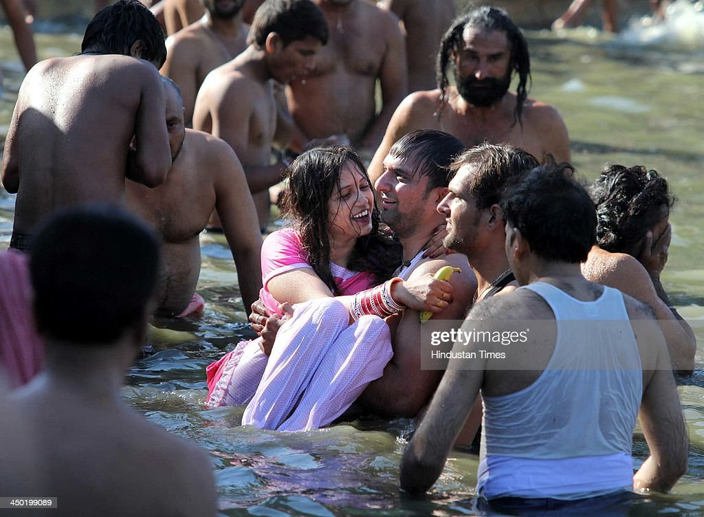 Devotees take a holy dip in a pond during the famous Jhiri fair - a village where 'blessed peasant Jitu' scarified his life fighting for the rights of tillers at Kanachak village on November 17, 2013 in Jammu, India. According to legend, the fair is held in memory of Baba Jitu, a simple and honest farmer who killed himself since he was not prepared to submit to the unjust demands of a landlord who wanted him to part with his crop.