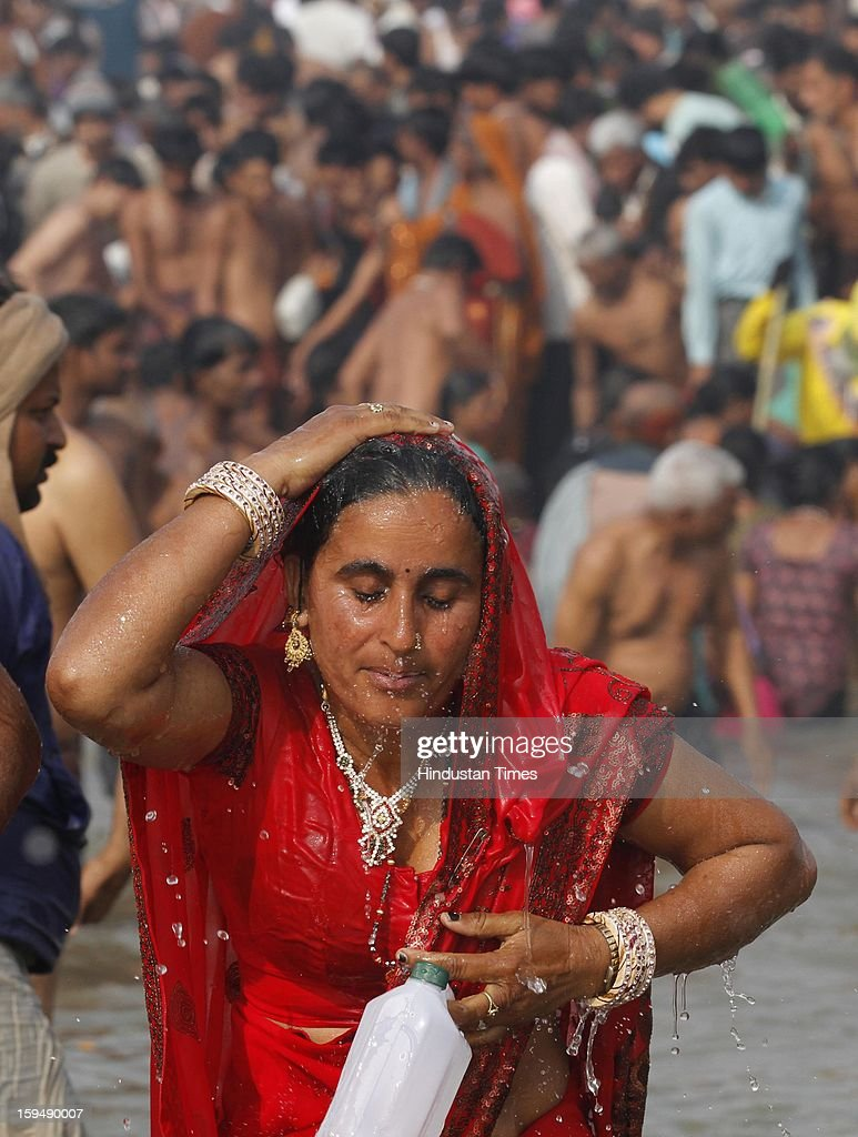 Devotees take first bath of Kumbh at the bank of Sangam confluence of river Ganga, Yamnuna and mythical Saraswati on the occasion of Makar Sankranti on January 14, 2013 in Allahabad, India. Kumbh is World's biggest religious gathering, in which more that 100 million of Hindus and sikh devotees will take part over next 55 days. Apart from being pilgrimage of faith, salvation and hope for millions of devotees, it also serve as meeting ground for the vast spectrum of Indian religious and spiritual views.