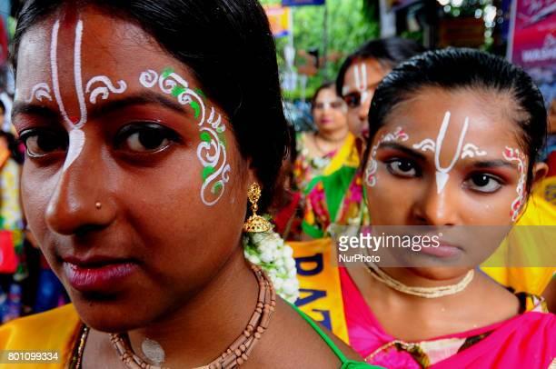 Devotees take part in Jagannath Rath Yatra organised by ISKCON Rath Yatra on June 252017 in Kolkata IndiaThe three deities of Jagannath Balabhadra...