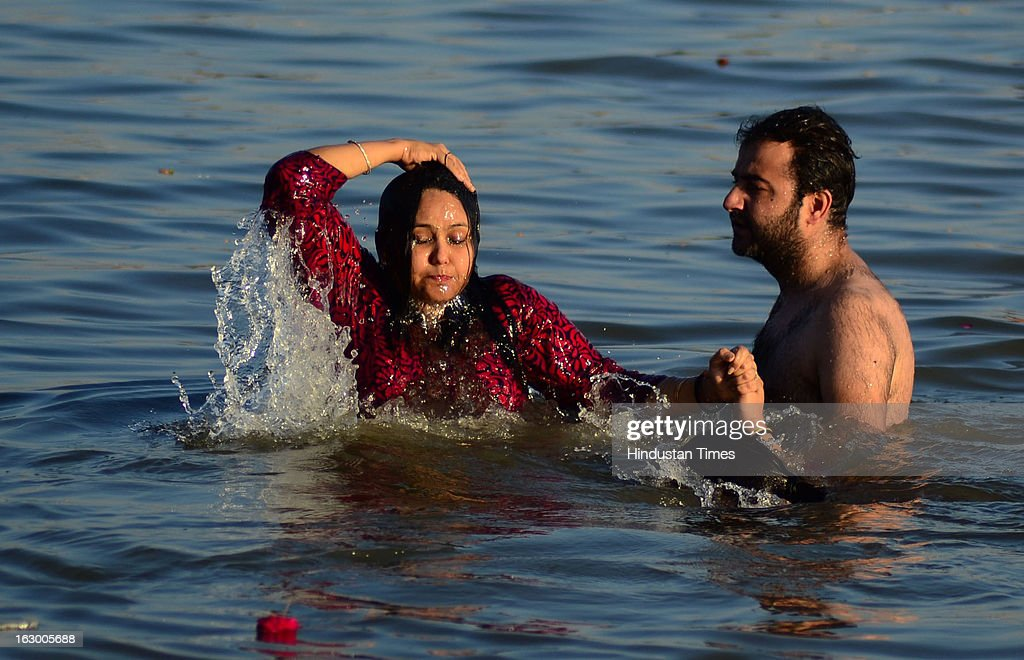 Devotees taking holy dip in Sangam waters in the Kumbh Mela area on March 3, 2013 in Allahabad, India. The mega religious fair, held once in 12 years, last official bathing on 'Maha Shivratri' on March 10, 2013.