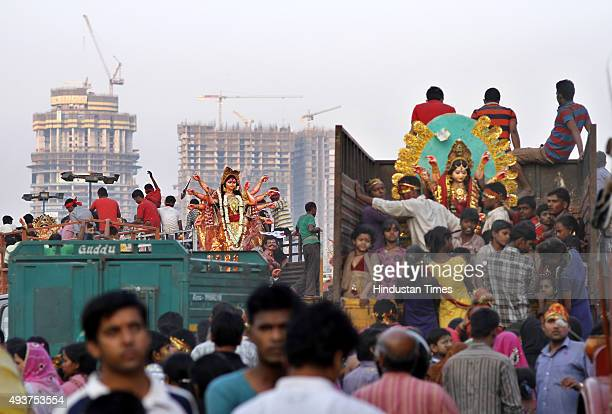 Devotees taking idol of Goddess Durga for immersion at river Yamuna near Okhla Barrage on the occasion of Dashmi on October 22 2015 in New Delhi...