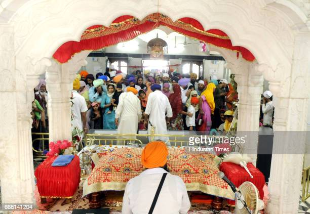 Devotees taking part in a special prayer session on the occasion of Baisakhi festival on April 13 2017 in Patiala India Baisakhi is a historical and...