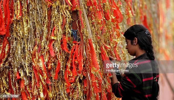 A devotees ties a Chunnari on the first day of Navratras at Babe Wali mata temple on October 13 2015 in Jammu India The ninedaylong Hindu Navratri...