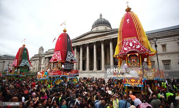 Devotee's to the Hare Krishna faith lead the Rathayatra procession into Trafalgar Square on June 9 2013 in London England Devotees of Lord Krishna...