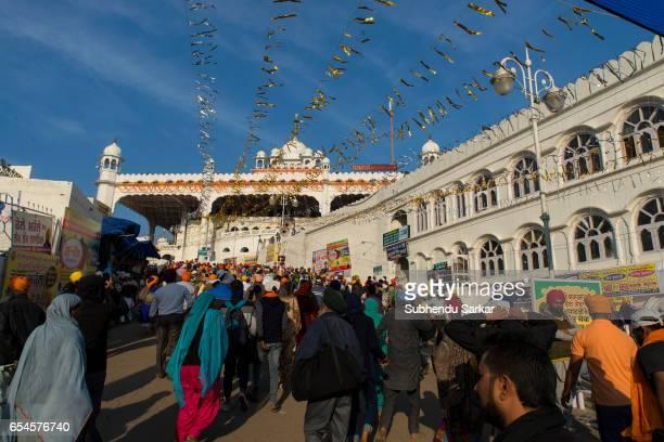 Devotees visit Kesaabgarh Sahib a gurudwara during Hola Mohalla festival Hola Mohalla is a threeday festival started by the tenth Sikh Guru Govind...