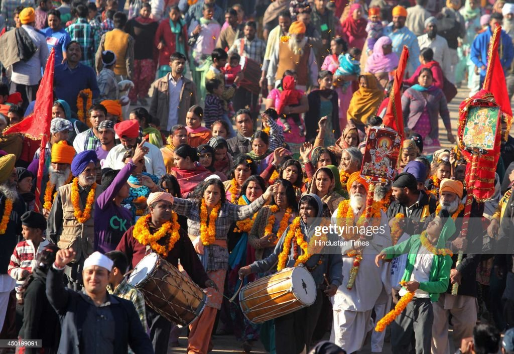 Devotees whirl their head to the beat of drums at a ritualistic performance during the famous Jhiri fair - a village where 'blessed peasant Jitu' scarified his life fighting for the rights of tillers at Kanachak village on November 17, 2013 in Jammu, India. According to legend, the fair is held in memory of Baba Jitu, a simple and honest farmer who killed himself since he was not prepared to submit to the unjust demands of a landlord who wanted him to part with his crop.