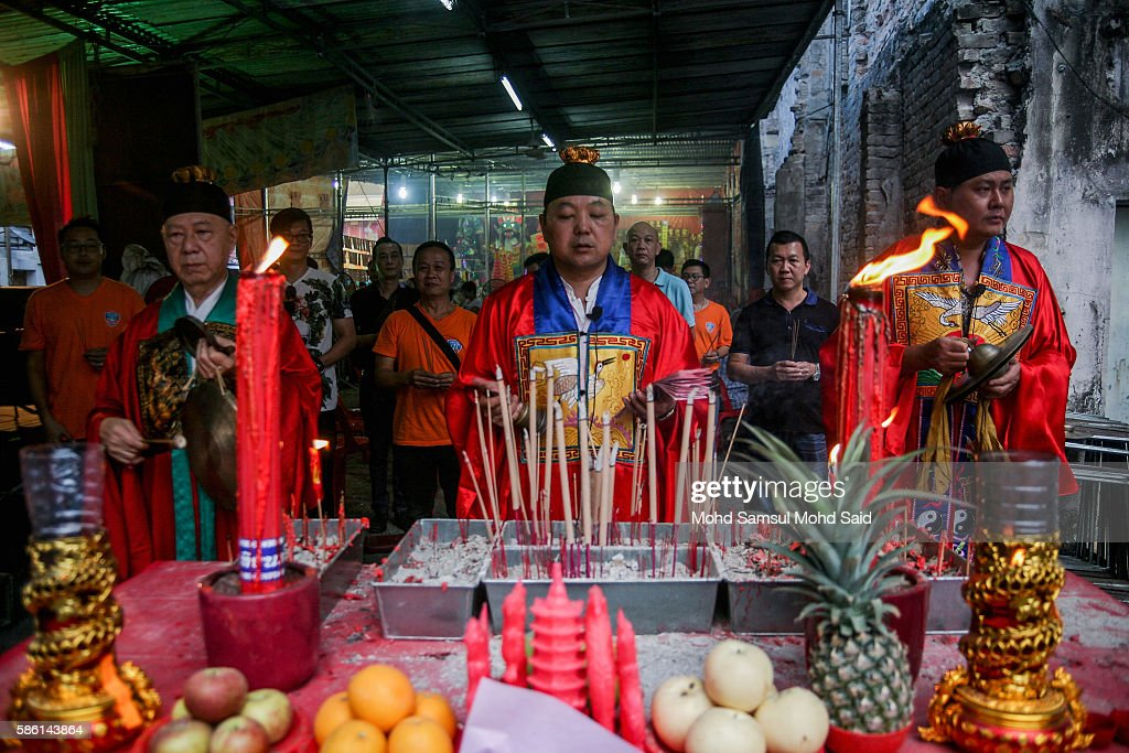 A devotes perform a prayer during Hungry Ghost Festival on August 5, 2016 in Kuala Lumpur, Malaysia. The Hungry Ghost Festival falls on the 15th day of the seventh lunar month. According to traditional Chinese belief, the seventh month in the lunar calendar is when restless spirits roam the earth. Many Chinese people make efforts to appease these transient ghosts, while feeding their own ancestors particularly on the 15th day, which is the Yu Lan or Hungry Ghost Festival.