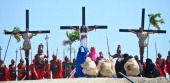 Devout Filipino Christians take part in a reenactment of Christ's crucifixion on March 29 2013 in Pampanga province Philippines Six people were...