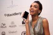 Devyn poses with a Blackberry Z10 smartphone at the Blackberry Style Lounge during MercedesBenz Fashion Week in Berlin on July 3 2013 in Berlin...