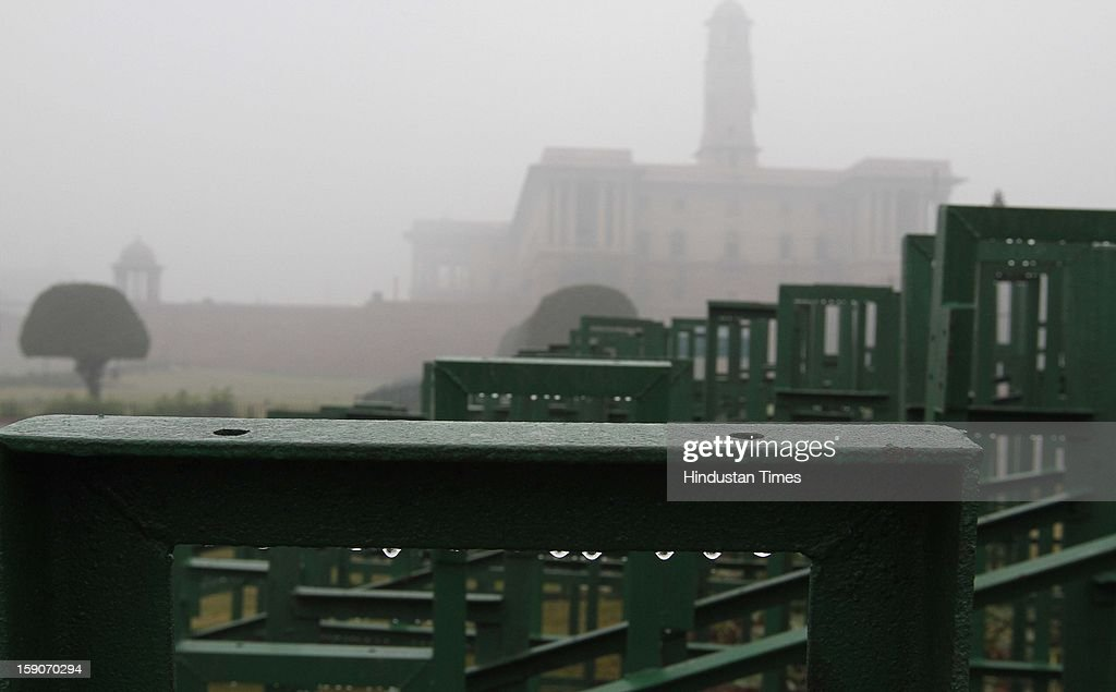 Dew forming on the barricades placed for Republic day parade near Raisana Hills on January 7, 2013 in New Delhi, India. Dense fog and icy winds disrupted normal life as Delhi's minimum temperature settled at five notches below average at 2.4 degrees Celsius. Fog forced visibility to drop to about 500 metres in the morning resulting in 15 flights and 42 trains were delayed out of Delhi while 18 trains got cancelled.
