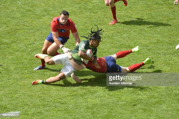 Dewald Human of South Africa is tackled during the HSBC rugby sevens match between Australia and Wales on May 13 2017 in Paris France