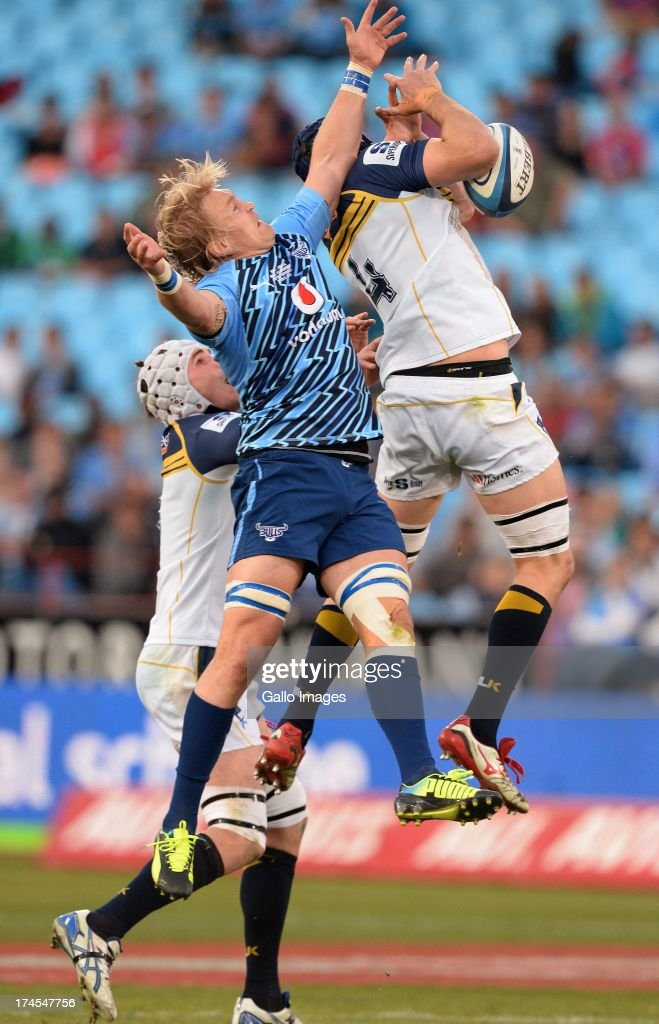 Dewald Potgieter of the Bulls and Scott Fardy (R) of Brumbies compete for a high ball during the SupeRugby semi final match between Vodacom Bulls and Brumbies at Loftus Versfeld Stadium on July 27, 2013 in Pretoria, South Africa.