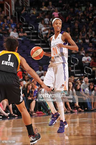 DeWanna Bonner of the Phoenix Mercury dribbles the ball against Brianna Kiesel of the Tulsa Shock on July 2 2015 at Talking Stick Resort Arena in...