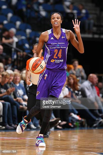 DeWanna Bonner of the Phoenix Mercury dribbles the ball and calls a play against the Minnesota Lynx during Game One of the WNBA Western Conference...