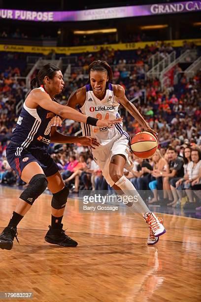 DeWanna Bonner of the Phoenix Mercury drives against Iziane Castro Marques of the Connecticut Sun on August 31 2013 at US Airways Center in Phoenix...