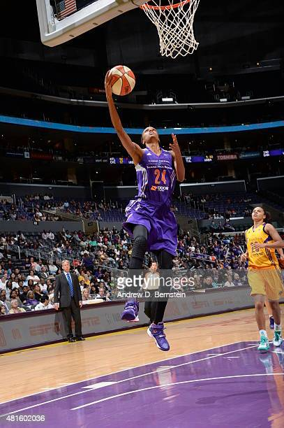 DeWanna Bonner of the Phoenix Mercury goes to the basket against the Los Angeles Sparks on July 21 2015 at Staples Center in Los Angeles California...