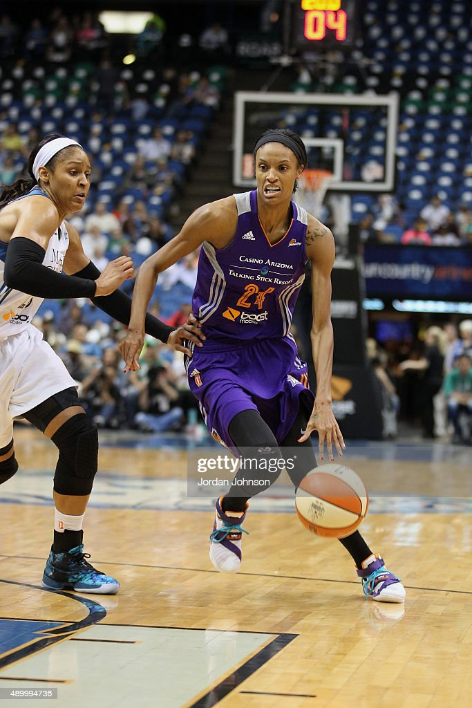 DeWanna Bonner of the Phoenix Mercury handles the ball against Maya Moore of the Minnesota Lynx during Game One of the WNBA Western Conference Finals...