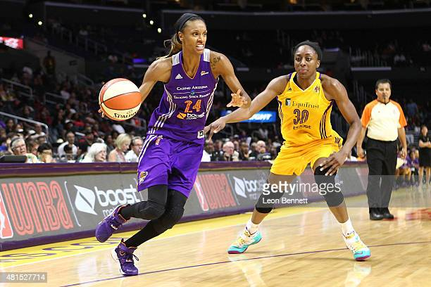 DeWanna Bonner of the Phoenix Mercury handles the ball against Nneka Ogwumike of the Los Angeles Sparks in a WNBA game at Staples Center on July 21...