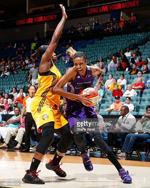 DeWanna Bonner of the Phoenix Mercury handles the ball against the Tulsa Shock on July 30 2015 at the BOK Center in Tulsa Oklahoma NOTE TO USER User...