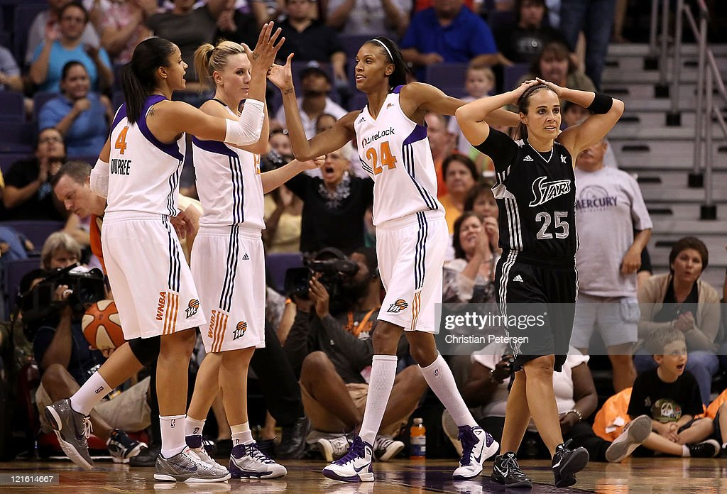 <a gi-track='captionPersonalityLinkClicked' href=/galleries/search?phrase=DeWanna+Bonner&family=editorial&specificpeople=4085058 ng-click='$event.stopPropagation()'>DeWanna Bonner</a> #24 of the Phoenix Mercury high-fives <a gi-track='captionPersonalityLinkClicked' href=/galleries/search?phrase=Candice+Dupree&family=editorial&specificpeople=537818 ng-click='$event.stopPropagation()'>Candice Dupree</a> #4 and <a gi-track='captionPersonalityLinkClicked' href=/galleries/search?phrase=Penny+Taylor&family=editorial&specificpeople=206985 ng-click='$event.stopPropagation()'>Penny Taylor</a> #13 after scoring past <a gi-track='captionPersonalityLinkClicked' href=/galleries/search?phrase=Becky+Hammon&family=editorial&specificpeople=203174 ng-click='$event.stopPropagation()'>Becky Hammon</a> #25 of the San Antonio Silver Stars during the WNBA game at US Airways Center on August 20, 2011 in Phoenix, Arizona. The Mercury defeated the Silver Stars 87-81.